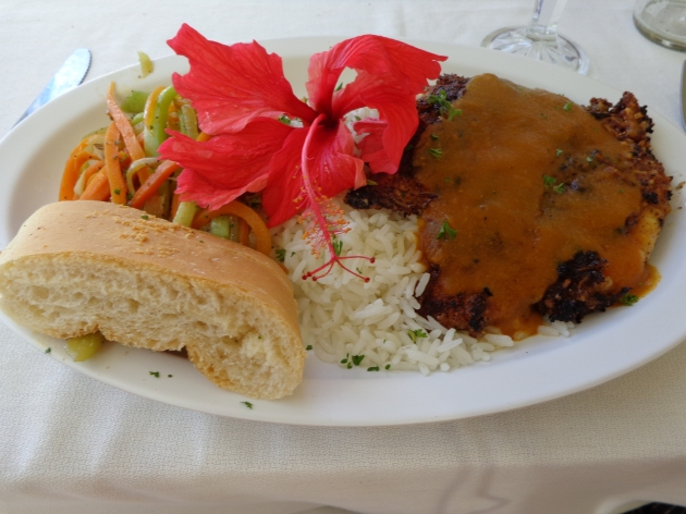 The main course, fried chicken breast with sauce, sauteed veggies and rice with a slice of bread